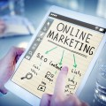 online-marketing-on-tablet-ipad-with-seo-content-blogs-pointing-finger