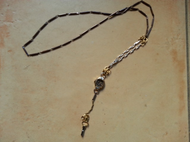 Custom-made Watch Necklace from authentic early 20th century watch and chain.