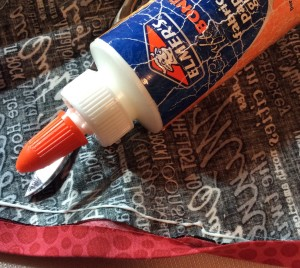 Apply thin line of glue next to stitching line--toward the binding