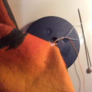 sewing on button by machine