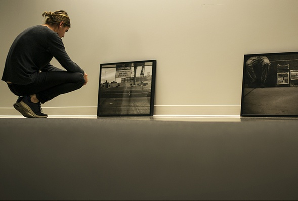 At the 'down to earth' exhibition Daniel Soares photographs are placed down at the floor