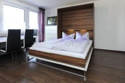 Wohnzimmer mit Bett
