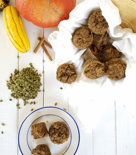 Pumpkin, spice and everything nice goes into these Nut-free Paleo Pumpkin Muffins that are now grain-free! Ground pumpkin seeds take the place of flour and great texture is achieved without eggs, making these vegan, too!