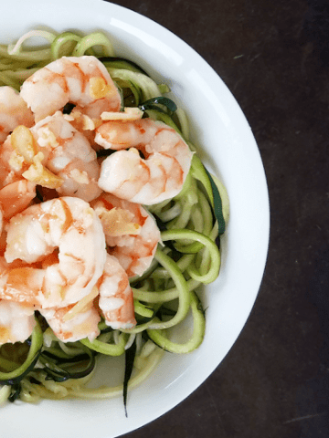 This mouth-watering garlic shrimp with zucchini pasta is quick and easy to make and is also gluten-free, grain-free, low-carb, low-glycemic and Primal. It's a healthy meal your whole family will love!