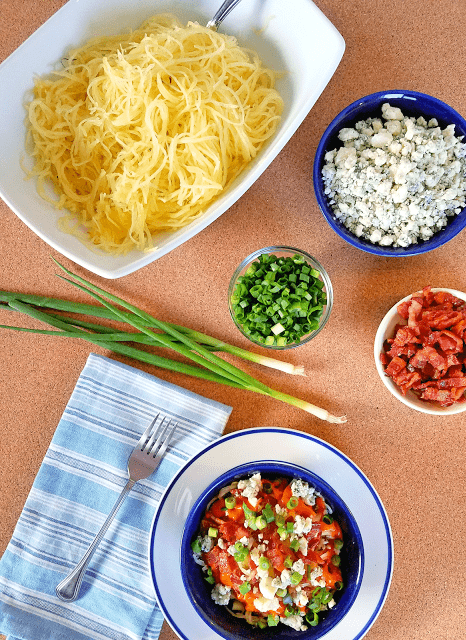 This Low Carb Buffalo Blue Cheese Spaghetti Squash with Chicken combines the bold flavors of football season in a healthy dish! Not only does the spaghetti squash provide a serving of vegetables, but it's grain-free, gluten-free and low-carb. With the chicken and blue cheese, this Low Carb Buffalo Blue Cheese Spaghetti Squash recipe is a meal in its own right that's Primal, keto diet-friendly and sure to satisfy.