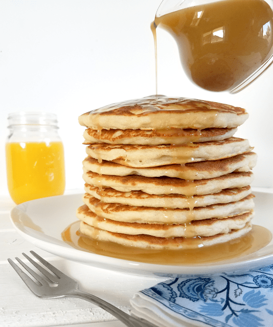 These gluten-free and vegan pancakes are more nutritious than traditional pancakes and taste like a cinnamon roll with the reduced-sugar Cinnabun Sauce!