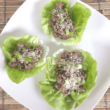 overhead photo of three Korean beef lettuce wraps on a plate