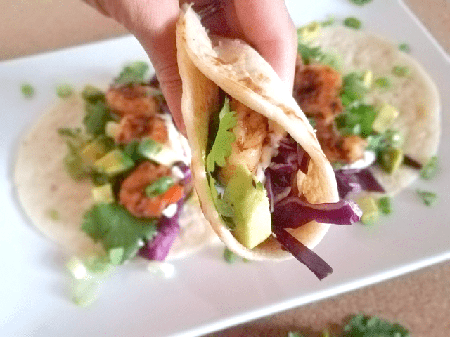 These Low Carb Shrimp Tacos with Lime Crema are full of flavor yet quick and easy to make! Nutritious, low-carb ingredients like avocado and cilantro provide lots of health benefits and it all stays wrapped up in a gluten-free almond flour tortilla that won't fall apart.