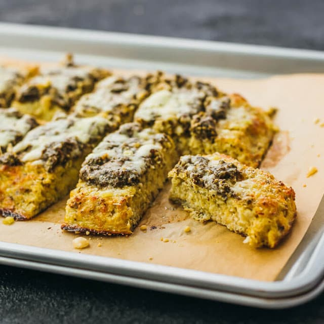 Cauliflower Flatbread with Pesto and Parmesan by Savory Tooth