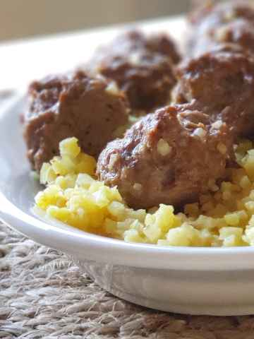 These Easy Lamb Meatballs over Saffron Cauliflower Rice only require 10 minutes prep time and cook in one pan, making this low-carb, keto, Paleo and Whole30 compliant Mediterranean-inspired recipe a great weeknight option!