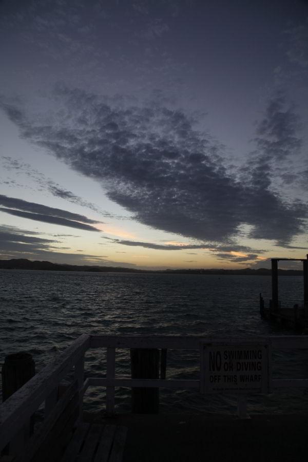 Sonnenunteragang in Russell an der Pier