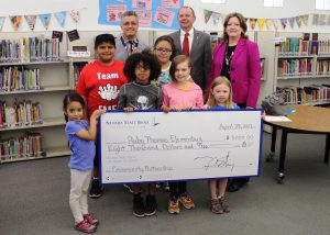 Nevada State Bank presented a check for $8,000 to Ruby Thomas Elementary School in celebration of Teach Children to Save, to support their education efforts