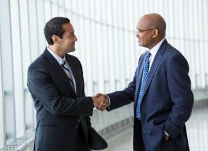 Two business professionals shaking hands. Click to learn more about First Independent Bank's experienced banking counsel for your practice.