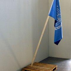 False Flag // NATO & UN flag stitched together, wood, Pallet // 2 x 1 m // 2012