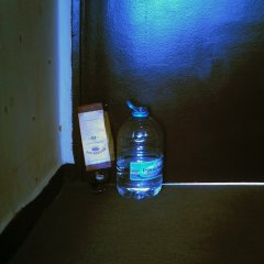 Paintaholics Security Device // Glass of Whiskey, Cardboard Box, 5lt. of Water // Dimensions Variable // 2007
