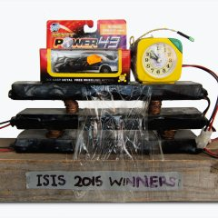 MI5-6 Al-CIA-da-ssoM False Flag Champions League Trophy Alarm Clock // John Behan, b. 1938 // 2 & 5 Cent coins, Batteries, Clock, Electrical Wiring, Duct tape, Cellophane tape, Tech 7, Model Car, Screws and Wood // 29x43x9cm // 2015