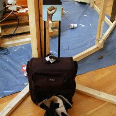 Behailu Bezabih Residual Residency // Suitcase, Boots, Cardboard, Digital Prints, Text // 120 x 45 x 30 cm // 2005
