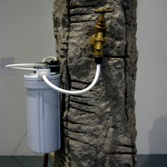 Gabon Saors' Fluoride Free Stone of ill: Bring Your Own Lithium // Cement, Sand, Peatmoss, Chicken Wire, Wood, Steel Rebar, Copper & Plastic Piping, Brass Tap, De-Fluoridation Filter System & Water // 90 x 50 x 65 cm // 2015