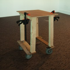 Disenfranchised Coffee Table // Wood, Screws, Bolts, Clamps, Trolley Wheels, Bricks // 120 x 50 x 50 cm // 2006