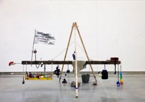 The Resurrection of Delacroix as a Battering Ram //Wood, Chain, Metal & Plastic Fittings, Crutch, Studio Equipment & Paint, Rocks, Concrete, Digital Prints // 400 x 200 x 160 cm // 2016