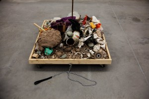 False Flag ² // Wood, Wheels, Rubbish, Steel, Dog Lead, Glove, Cardboard, Wire, Canvas // 500 x 100 x 100 cm // 2016