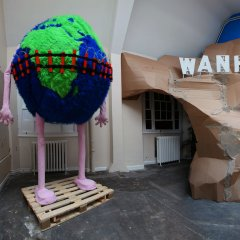 The Global Errorist's Sustainable Suicide // Wood, Screws, Stuffing, Packaging Tape, Cardboard Tubing, Pallet, Fake Fur, Cotton // 400 x 200 x 200 cm // 2011