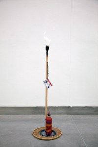 Evidence Plant: Monument to M // Wood, Paint, Polyurethane, Glue, Camping Fuel Container, Tie Wraps, String, Eyelets, Cardboard, Glue, Hose Pipe, Sand, Laminated Digital Print // 120 x 40x 40 cm // 2016