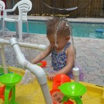 baby playing in DIY fountain