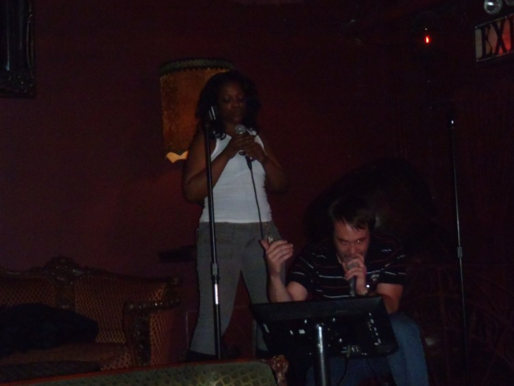"Dan singing karaoke with Shalonda, ""Empire State of Mind"", in New York City"
