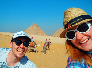 Never Ending Honeymoon | Jacqui and Dan on camels at the Great Pyramids of Giza in Egypt