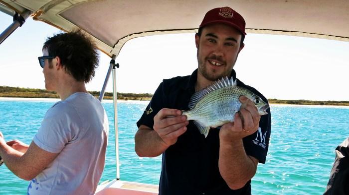 On a boat Skip Dan with fish