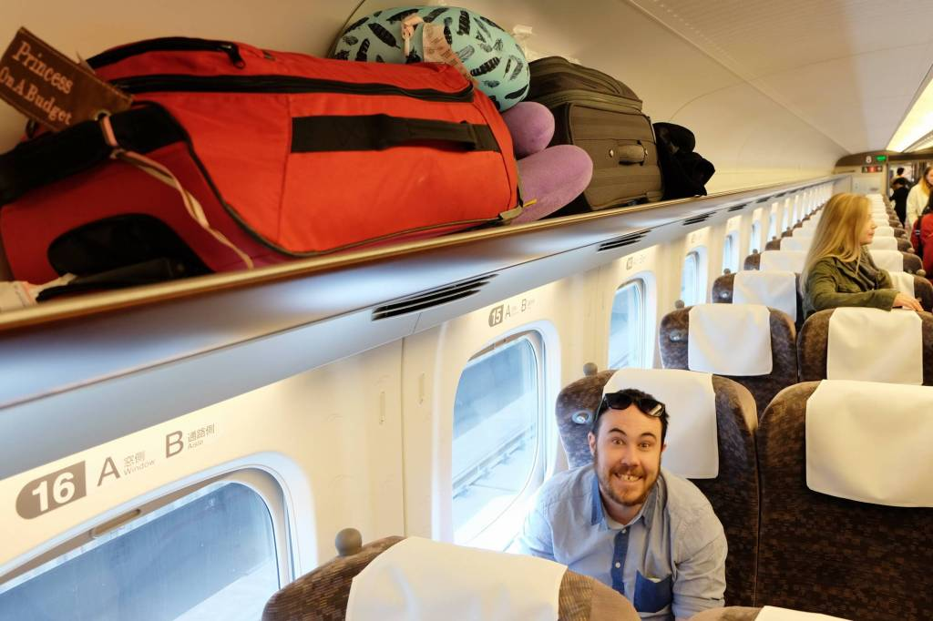 Journey through Japan: Dan and luggage on a Japan train