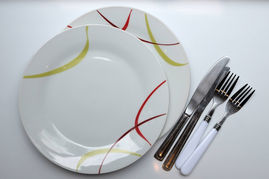 Plates knifes and forks