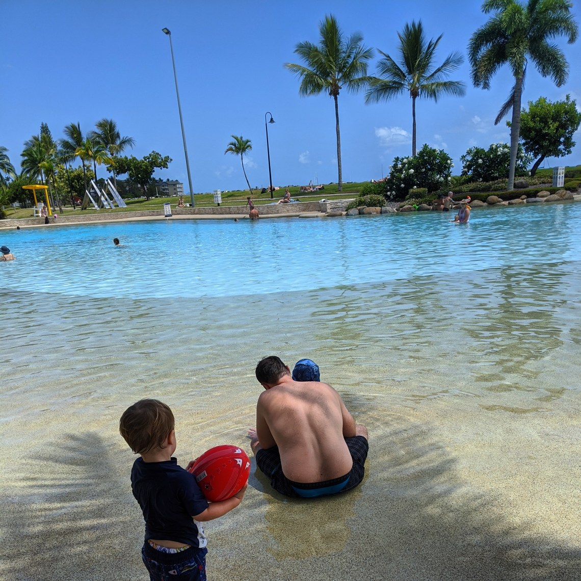 Swimming in Airlie Beach Lagoon - dad and two kids