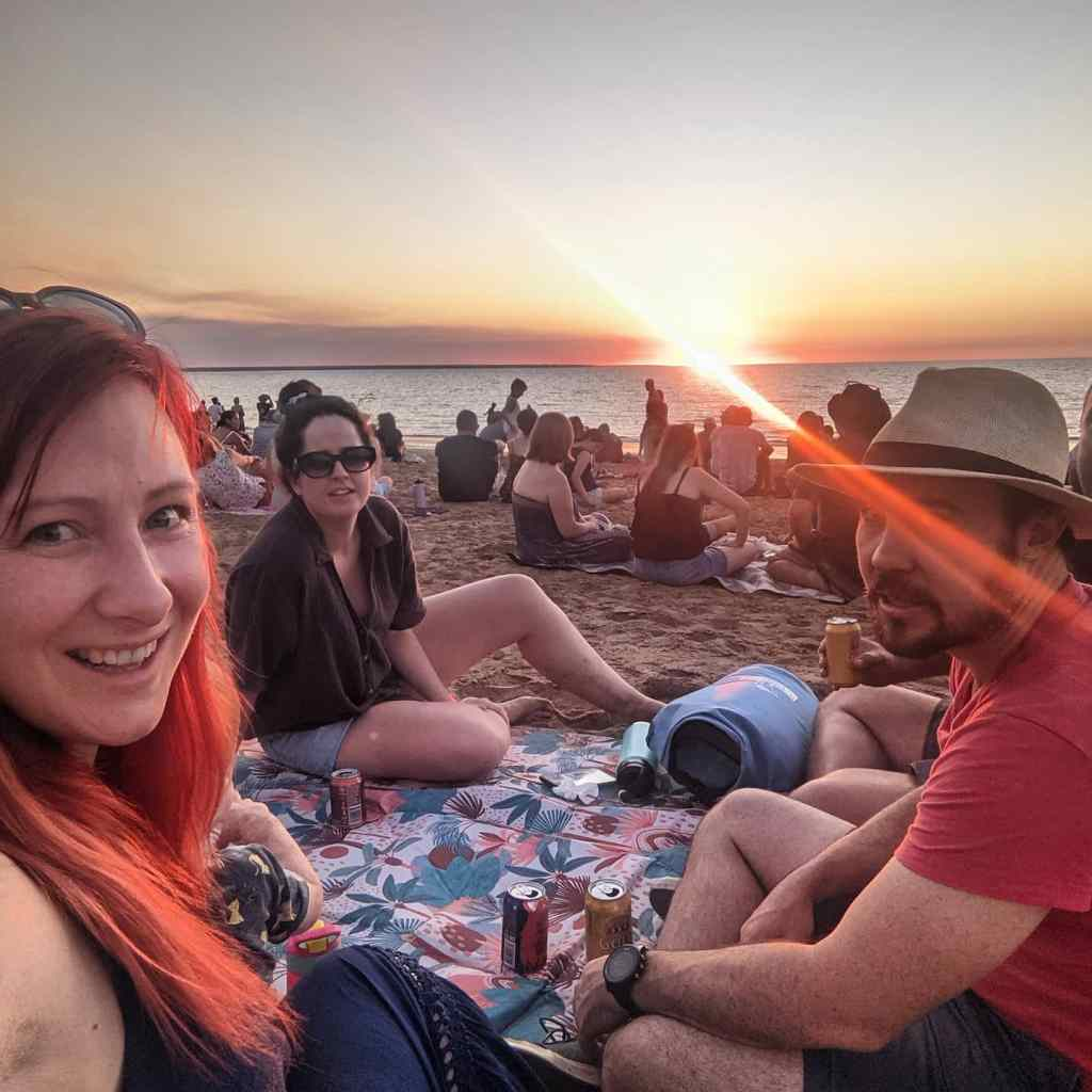 A picnic scene at Mindil Beach in Darwin with sunset in the background