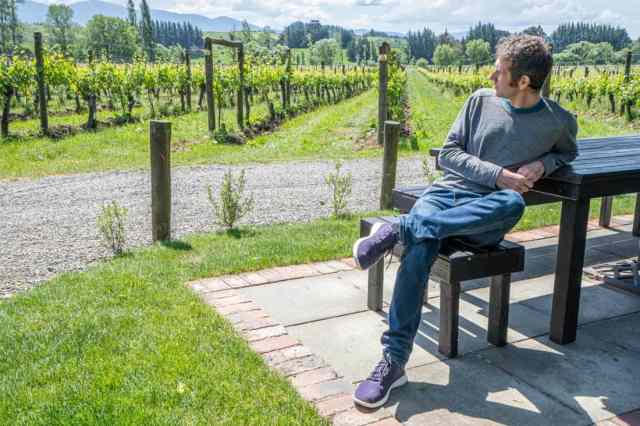 Simon wearing his lighter Allbird Tree Runners at a Nelson vineyard in New Zealand