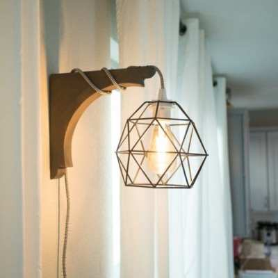 This diy corbel light doesnt require a drill. You can build this industrial diy corbel light sconce in under 30 minutes. #mydarlingdesign adarlingdesign.co