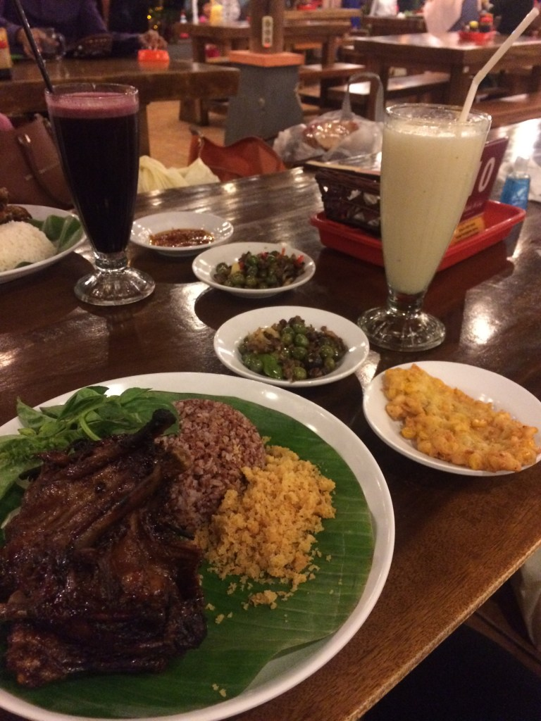 Dinner out in Bandung! Duck and rice and corn fritters and who knows what else!