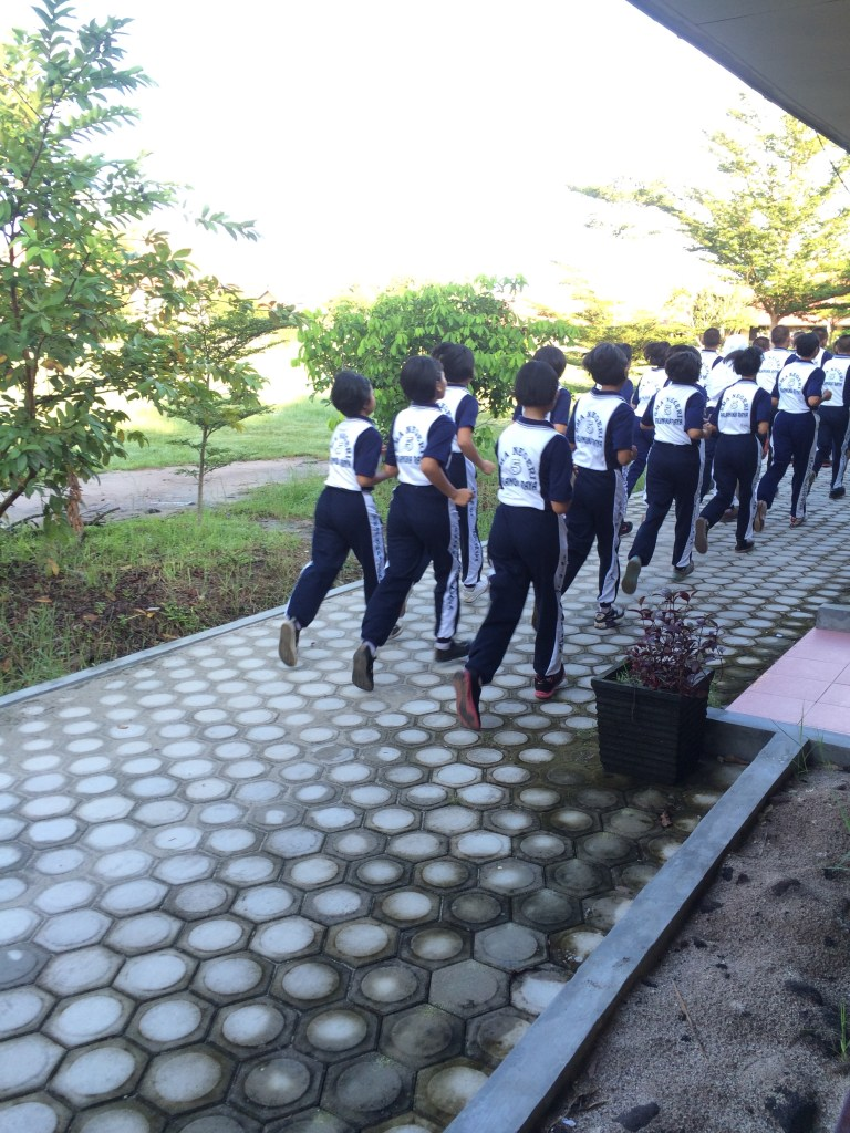 Everything is done military style... even their jogging during PE is done in perfect lines