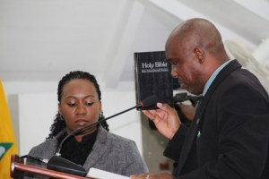 Hon. Carlisle Powell takes his oath as a member of the Opposition at the Nevis Island Assembly