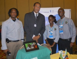 Senior Youth Officer Pierre Liburd (left) and Minister Phillip with two members of SKBC