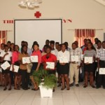 Participants of the 10th annual Summer Job Attachment Programme hosted by the Youth Affairs Division in the Ministry of Social Development showing off their Certificates of Completion at the close of the programme on August 23, 2013