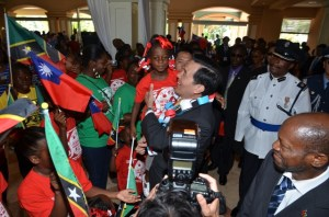 President of the Republic of China (Taiwan), His Excellency Dr. Ma Ying-jeou holds a child at the St. Kitts Marriott Resort. Right is St. Kitts and Nevis' Prime Minister the Rt. Hon. Dr. Denzil L. Douglas.