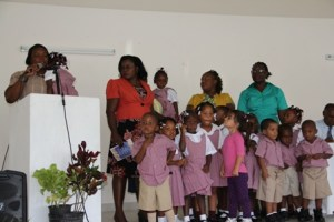 Staff and students of the first Combermere Pre School at the facility's official opening on September 02, 2013 at Franklyn Browne Community Centre at Camps Village. Education Officer responsible for Early Childhood Education Mrs. Florence Smithen (second from left) assists with students