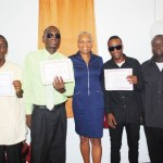 History-makers pose with a proud Minister of Health Hon Marcella Liburd (centre). They are, from left, George Prentice, Roland Marryshow, Javin Maynard and Jareem Huggins.