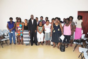 Nevisian businesswomen WISE grant beneficiaries pose for a group picture with Minister Nisbett.