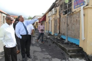 Prime Minister of St. Kitts and Nevis the Right Hon. Dr. Denzil Douglas tours the burnt Treasury Building in Charlestown with Premier of Nevis Hon. Vance Amory on January 24, 2014