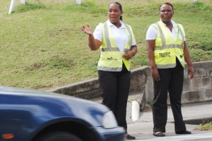 PEP Traffic Wardens Ms Odessa Lewis (left) and Ms Myrtle Barzey at work on the busy Cayon Street.