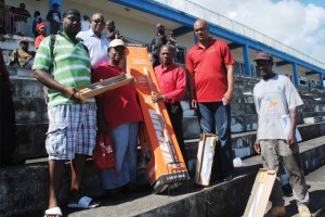 PEP workers received work tools from the Prime Minister. Picture shows from left Mr Devon Richardson, PEP Supervisor Lavington; Ms Marjorie Rawlins, PEP