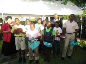 Primary and Secondary School quiz winners with Executive Director of the Nevis Historical and Conservation Society Evelyn Henville (extreme left back row), Tourism Education Officer in the Ministry of Tourism Vanessa Webbe (second from right back row) and Deputy Premier of Nevis and Minister of Culture Hon. Mark Brantley (extreme right back row). The contests were coordinated by the Society and the Ministry of Tourism in collaboration with VON Radio